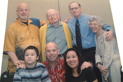 Pictured in photo: Top row, L to R, Sean Furey, James Furey (Dad), Dan Gable, Kathleen Furey; Bottom row, L to R, Frank Furey, Matt Furey, Zhannie Furey